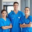 Group of young hospital workers in scrubs — Stock Photo #14901433