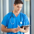 Royalty-Free Stock Photo: Male medical worker using tablet computer in hospital