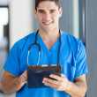 Royalty-Free Stock Photo: Male medical doctor using tablet computer in hospital