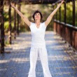 Healthy middle aged woman arms reach out — Stockfoto