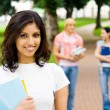 Beautiful young college student on campus — Stock Photo