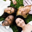 Stock Photo: Group of young diversity lying on grass