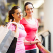 Two young women shopping in mall — Stock Photo #14904193