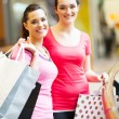 Two lady friends shopping in mall — Stock Photo