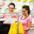 Two young women shopping for clothes in sports shop — Stock Photo