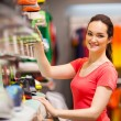 Sportswear shop assistant portrait inside store — Stock Photo #14904283