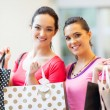 Stock Photo: Happy young women with shopping bags