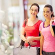 Stock Photo: Two happy friends shopping in mall