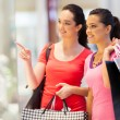 Stock Photo: Two young women shopping in mall