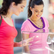 Two young women shopping for jewellery — Stock Photo