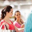 Young women shopping for bathrobe — Stock Photo