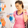Attractive young woman shopping for underwear in clothing store — Stock Photo #14904569