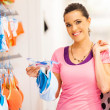 Young woman shopping for lingerie in clothing store - Stock Photo