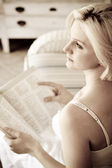 Elegant young woman reading book at home — Stock Photo