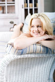 Happy woman relaxing at home — Stock Photo