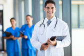 Young medical doctor and staff in hospital — Stock Photo