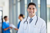 Happy male medical doctor portrait in hospital — Stock Photo