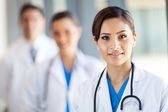 Beautiful healthcare workers portrait in hospital — Stockfoto
