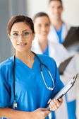 Team of medical doctors portrait in hospital — Stock Photo