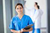 Beautiful young medical intern in hospital — Stock Photo