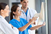 Group of medical workers working together in hospital — Stock Photo