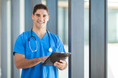 Happy male healthcare worker with tablet computer — Stock Photo