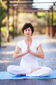 Middle aged woman yoga meditation — Stock Photo