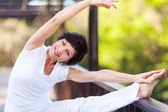 Active middle aged woman stretching — Stock Photo