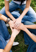 Young put hands together as a team — Stock Photo