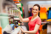 Sportswear shop assistant portrait inside store — Stock Photo