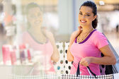 Happy young woman shopping spree — Stock Photo