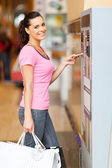 Young woman paying for parking at pay point — Stock Photo