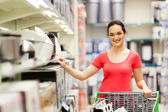 Young woman shopping for appliance in supermarket — Stock Photo