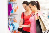 Young woman shopping for lingerie in clothing store — Stock Photo
