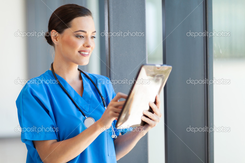 Beautiful female medical doctor using tablet computer in hospital — Stock Photo #14901509