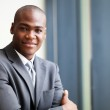 Peaceful african american businessman in office — Stock Photo #14964437