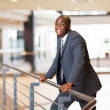 Foto Stock: African american businessman in modern office building