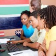 Group of adult african students learning computer together — Stock Photo