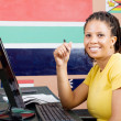 Royalty-Free Stock Photo: Young confident african american student in front of computer