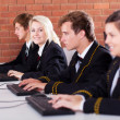 Group of high school students using computers in classroom — Stock Photo #14966265