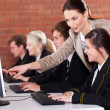 Stock Photo: High school teacher teaching in computer room