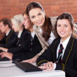 High school teacher and students in computer room — Stock Photo #14966277