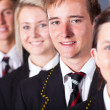 Group of high school students in uniforms closeup portrait — Stock Photo #14966445