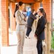 High school teacher talking to student by school corridor — Stock Photo
