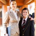 Female high school teacher and student portrait — Stock Photo