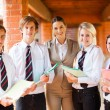 High school teacher and students portrait — Stock Photo