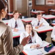 Female high school teacher teaching in classroom — ストック写真