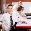 Cute female high school student in classroom — Stock Photo