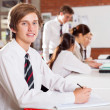 High school boy portrait in classroom — Stock Photo