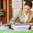Pretty female school teacher working in office — Stok fotoğraf